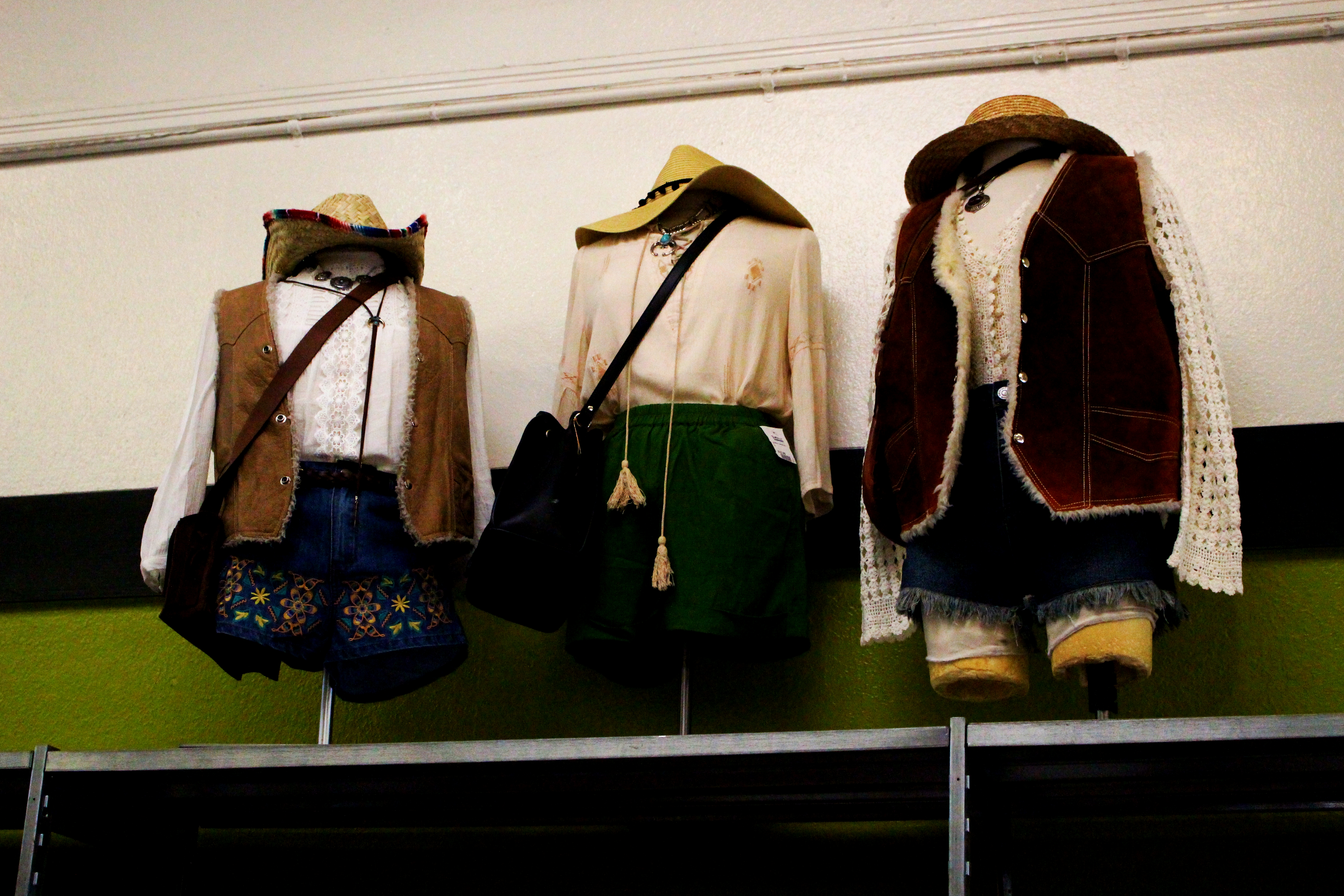 Three outfits are put on display. Credit: Fiona Belk / M-A Chronicle.