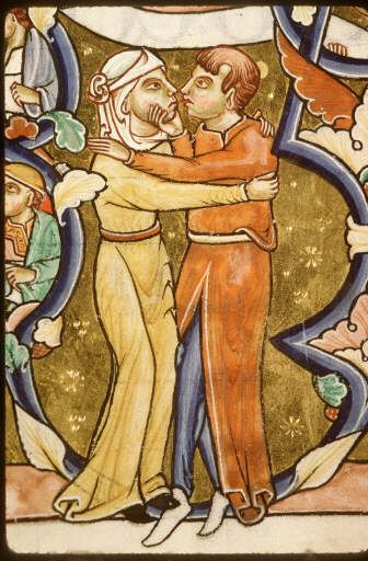 He is wearing a long tunic with a slit up the middle. Underneath he is wearing blue hose without feet. She is wearing a belted tunic. Both have narrow sleeves. She is wearing a veil while he is bare headed. c. 1185-1195