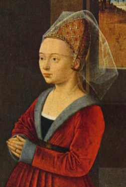 "Hair is pulled back in an embroidered ""beehive"" hennin and covered by a short veil. The veil reaches the eyebrows. Burgundy, ca. 1455."