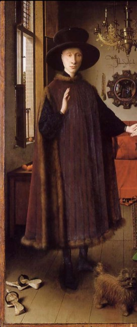 He is wearing a heuque: Sleeveless outer garment joined only at the shoulders. 1434