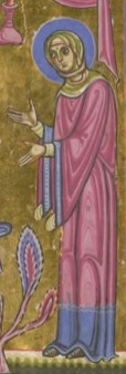 Woman wearing a wide sleeved surcote with a wide sleeved cote underneath, that peeks out in the sleeve openings. She wears a wrap around veil. c. 1050