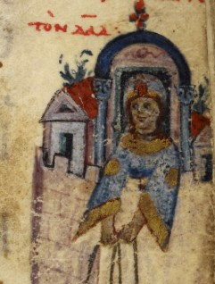 Lady in a window. She is wearing a blue gown with gold details. Her sleeves are wide and looks to be on a over-gown.