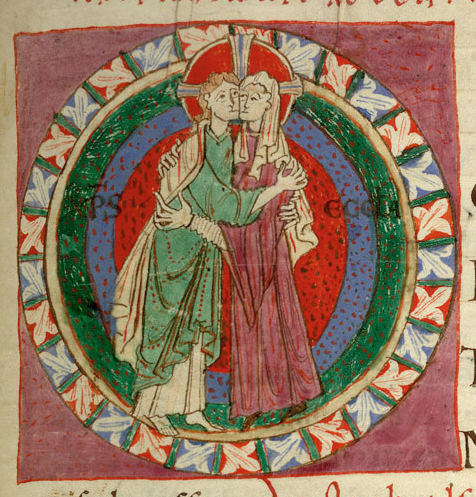 Couple embraising. They both wear long tunics, hers with wider sleeves than his. They both wear a long shirt/cote under it. Hers has long sleeves, while his doesn't. 1097