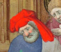 Grey bearded man with a large nose and wearing a very red chaperon arranged on his head. c. 1410-1430 the Bedford Hours c. 1410-1430