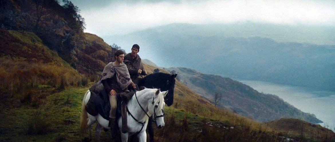 Two main characters in The Eagle riding their horses through Scottish highlands