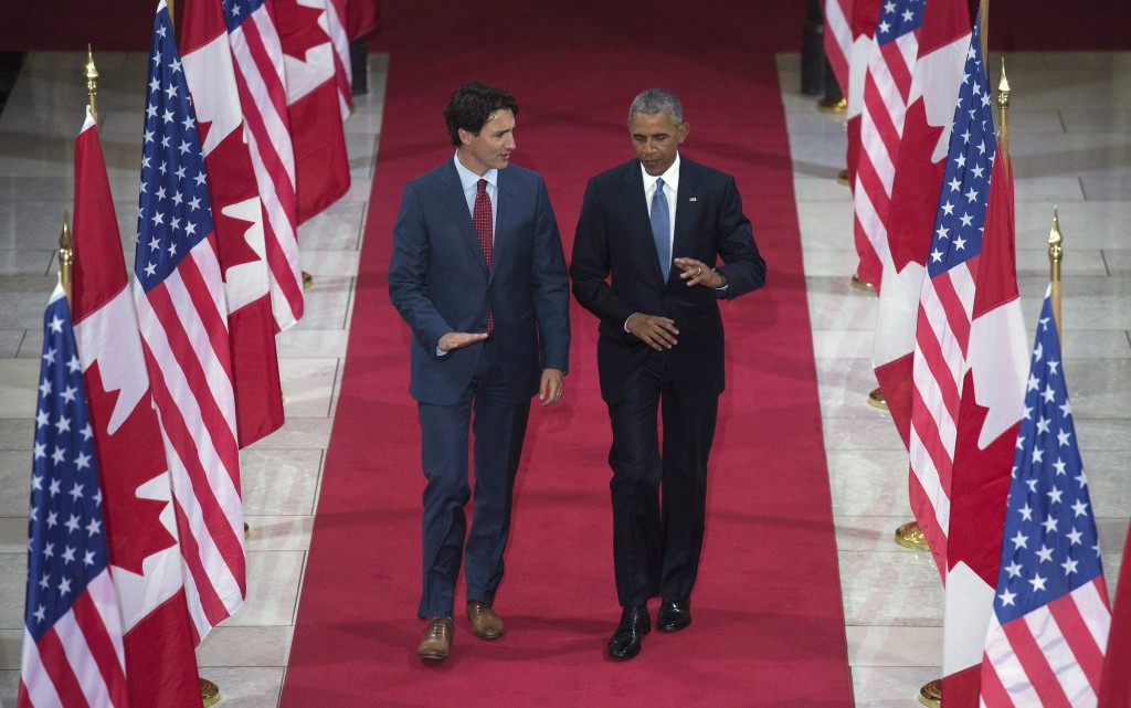 Prime Minister Justin Trudeau speaks with United States President Barack Obama as they walk through the Hall of Honour on Parliament Hill in Ottawa, Wednesday June 29, 2016. THE CANADIAN PRESS/Adrian Wyld