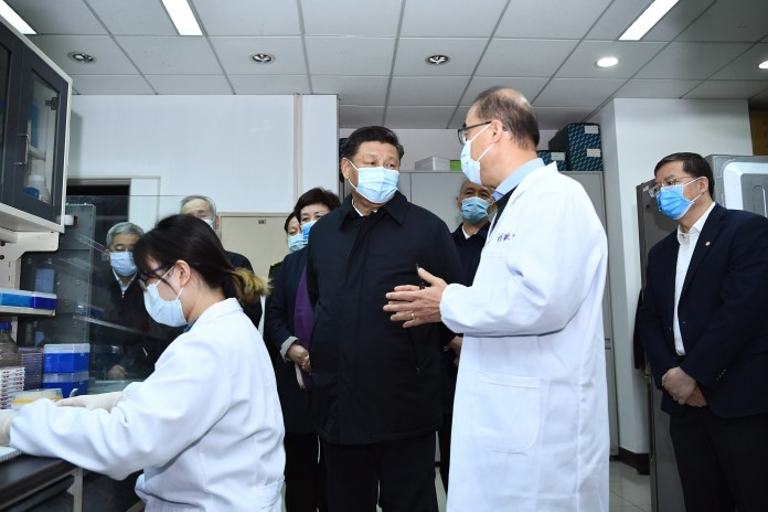 Chinese President Xi Jinping chats with experts during his visit to the Tsinghua University School of Medicine in Beijing, China, March 2, 2020. (Yan Yan / Xinhua / Getty Images)