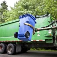 recycling truck picking up bin