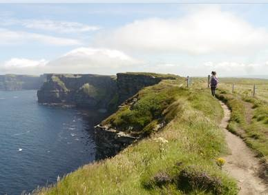 hiker walking on the cliffs of Moher