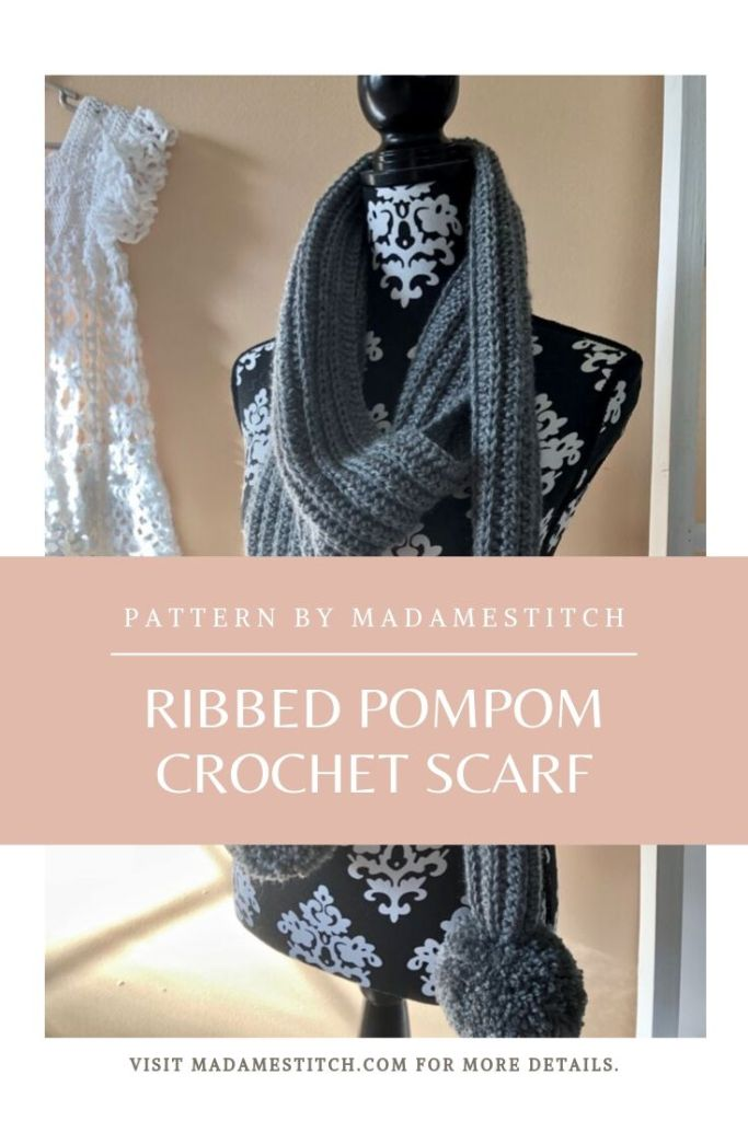 Ribbed Pompom Scarf | Crochet pattern by MadameStitch. A quick and easy crochet pattern, this scarf looks like a knit rib, worked lengthwise with attached pompoms. Made with Lion Brand Touch of Alpaca, a worsted weight. The perfect winter accessory. #madamestitch #crochetpattern #crochetscarfyarn.