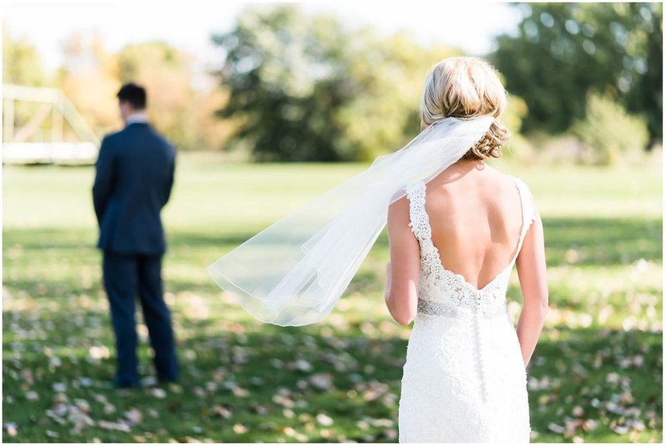 Bride sneaking up on groom for first look | Maddie Peschong Photography