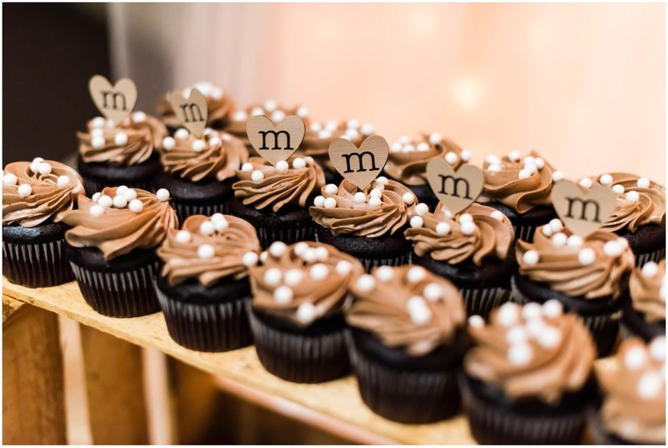 Chocolate cupcakes with initials at wedding reception | Maddie Peschong Photography