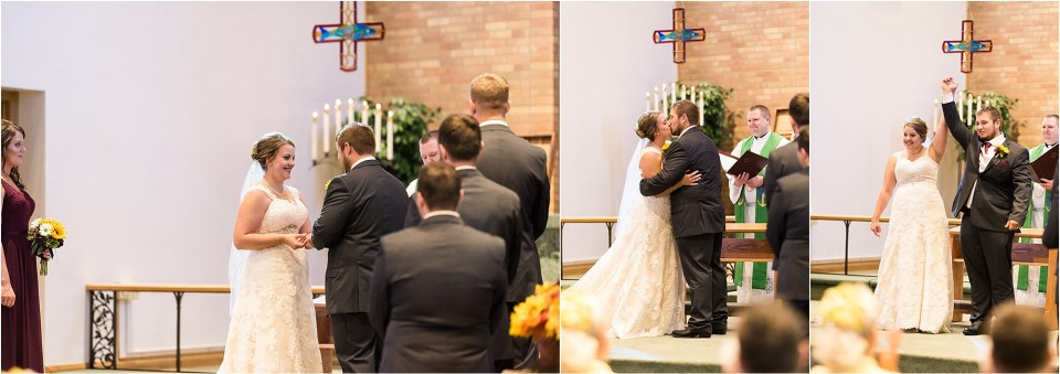 bride and groom first kiss at church wedding