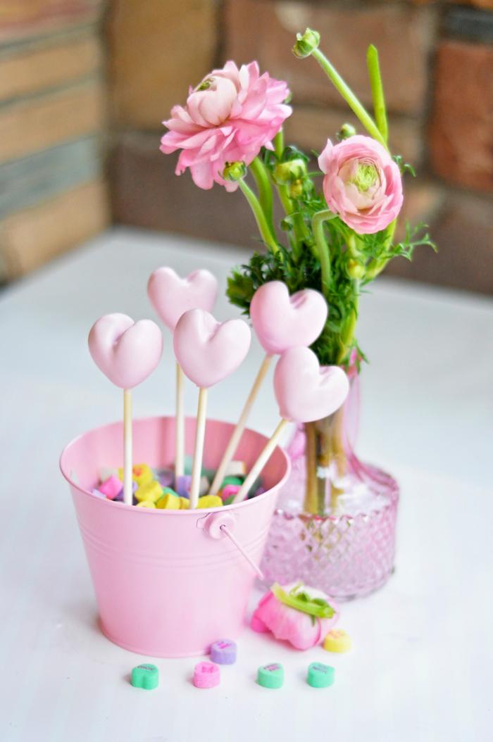 Valentines Day Garden Party heart cake pops in conversation hearts