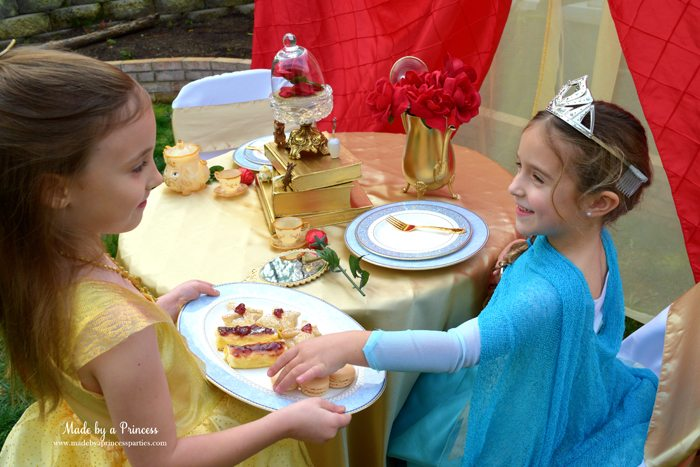 Beauty-and-the-Beast-Movie-Tea-Party-for-Two-belle-offering-elsa-treats