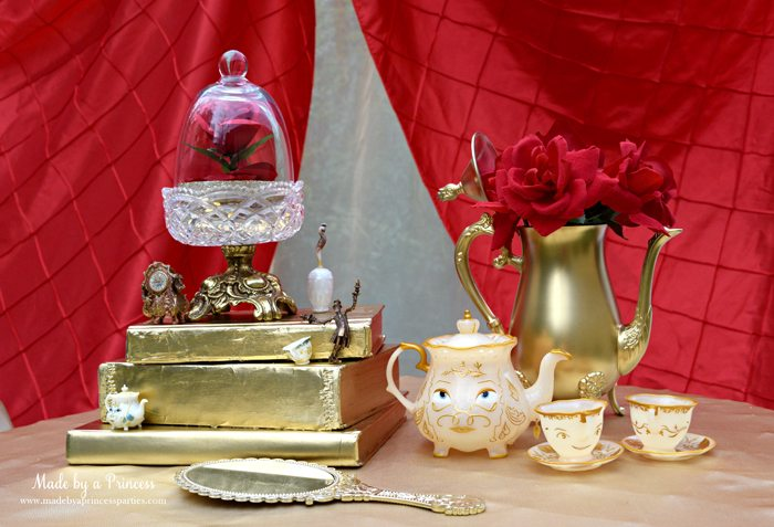Beauty-and-the-Beast-Movie-Tea-Party-for-Two-centerpiece-with-red-rose-books-tea-pot-chip-enchanted-mirror