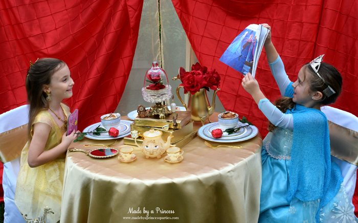 Beauty-and-the-Beast-Movie-Tea-Party-for-Two-elsa-telling-belle-her-story