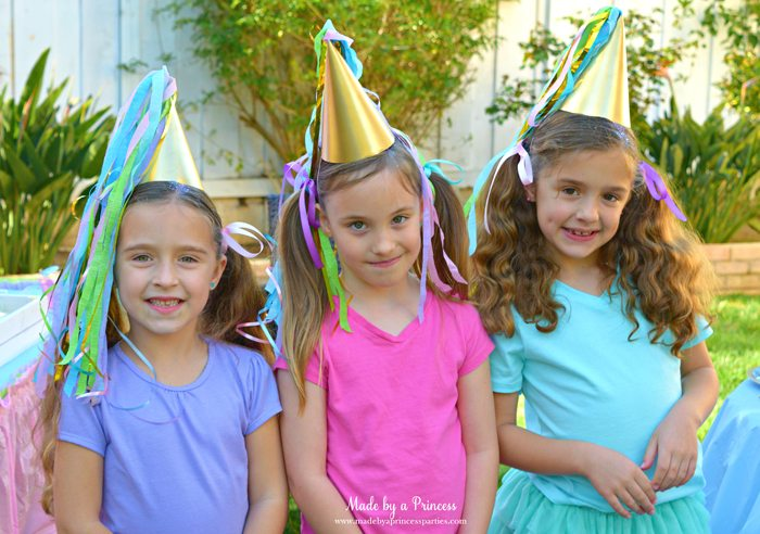 unicorn princess party hat idea tutorial custom hat made from crepe paper and curling ribbon little guests looking so cute