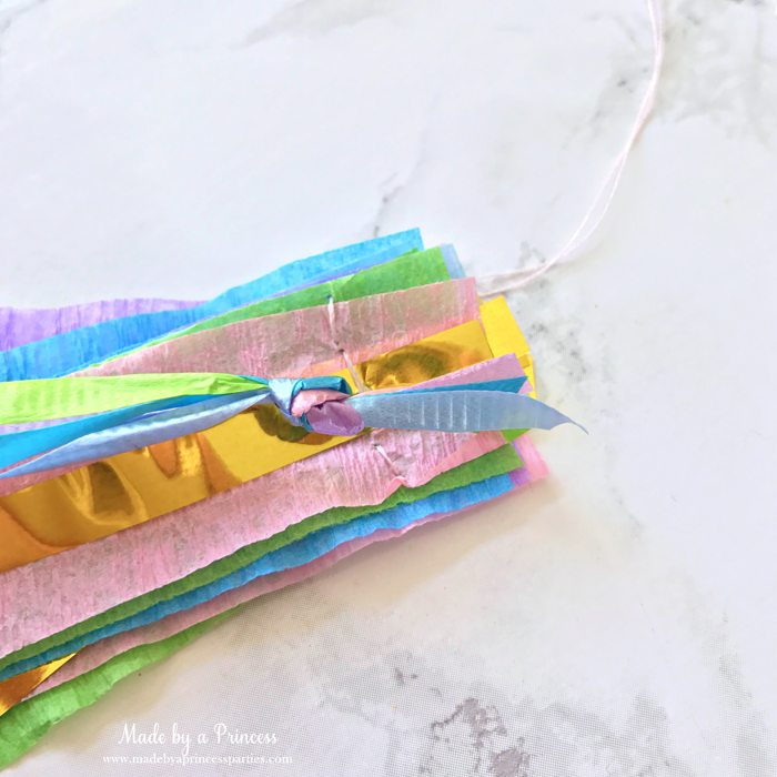 unicorn princess party hat idea tutorial tie curling ribbon together and place on crepe and gold fringe layers
