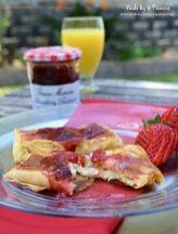 Savory Strawberry Preserves Toasted Coconut Almond Chicken Blintz Recipe served with orange juice