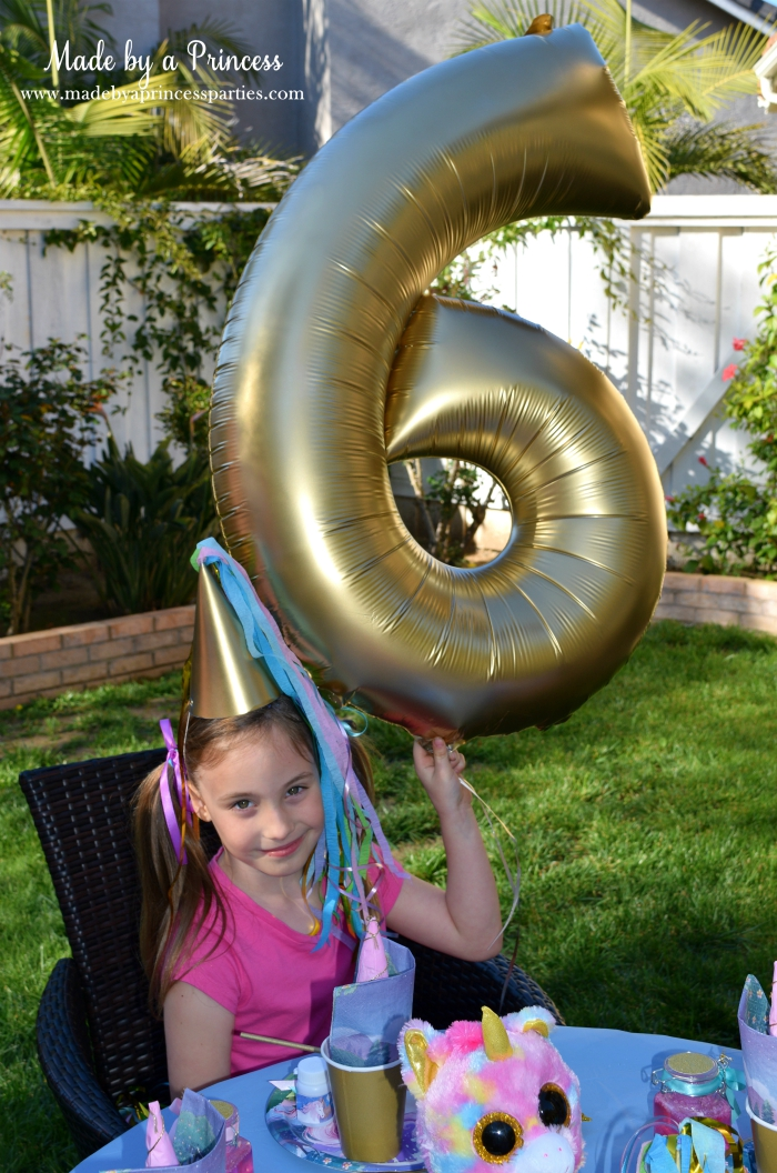 Unicorn Party Ideas Spray Paint Number Balloon Gold - Made by a Princess #unicorn #unicornparty
