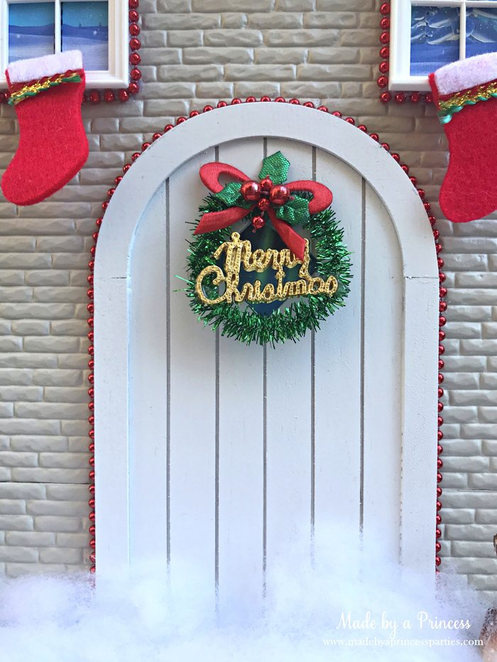 How to Create Your Own Tiny Elf Door Tutorial add wreath to door MadebyaPrincess #elfdoor #fairydoor #elfdoorkit