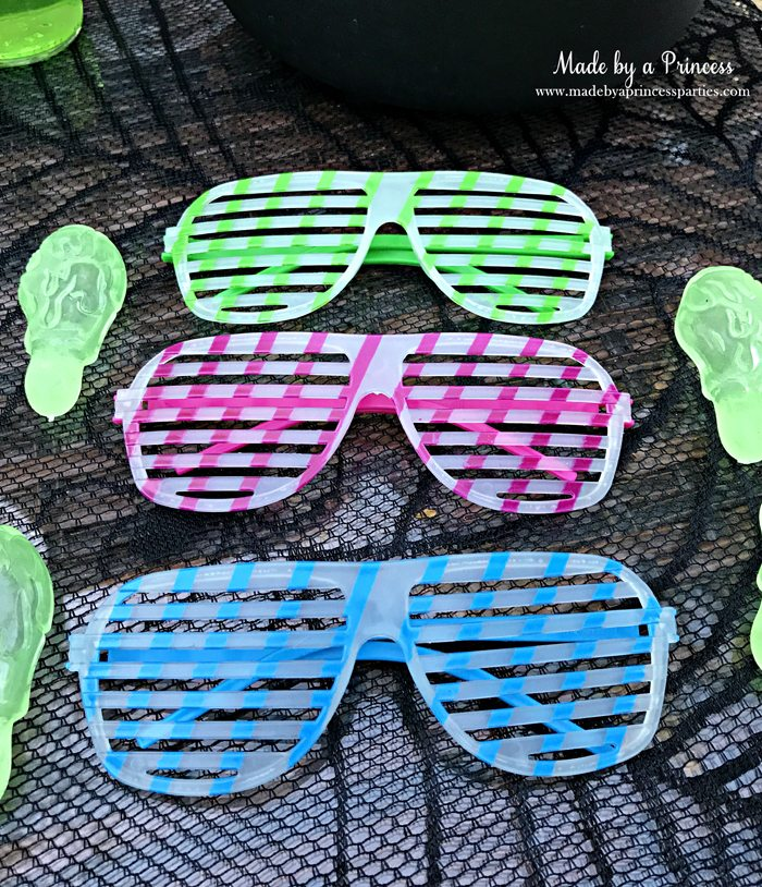 Teen Halloween Party Ideas glow in the dark sunglasses and snot rockets Made by a Princess #halloweenparty #teenhalloween