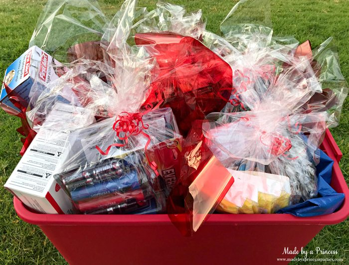 Unique School Silent Auction Idea Emergency Preparedness Kit items wrapped in cellophane in bucket ready to take home