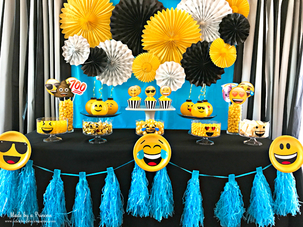 Emoji party idea use a garland and emoji party plate to decorate