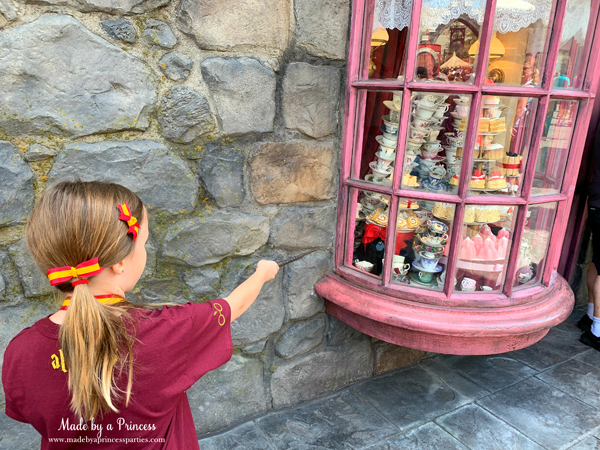 Universal Studios Hollywood make the treats spin with your wand in the window at Madam Puddifoots