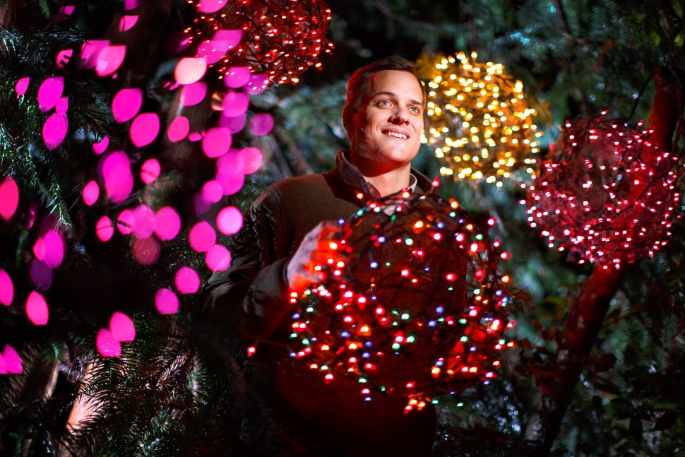 "Justin Smith with some of his ""tree ball"" creations he and his family are known for on Tuesday, November 10, 2015, in Greensboro, N.C. JERRY WOLFORD and SCOTT MUTHERSBAUGH / Perfecta Visuals A teenage Justin Smith grinned with excitement as he launched the lighted Christmas balls his family crafted of chicken wire and colorful holiday lights high into the trees in his yard with his homemade potato gun. Over the next nineteen years, Justin helped his family's DIY project evolve into a community endeavor that would provide close to one million meals for the hungry. He praises his parents for showing him how to simultaneously help others, have fun and work hard. ""I have been able to see that this way of living is commonplace."" As a financial planner, he helps people with their money. As a mentor for youth leaders, he guides young males as they lead their communities. As a board member for Crescent Rotary, he lends a hand to people in need. Justin aims to raise his three children with the same sense of community that he was raised with. ""My hope is that my family and I create this environment of being selfless and being passionate for somebody else and my kids get to combine fun and community with doing something bigger."""