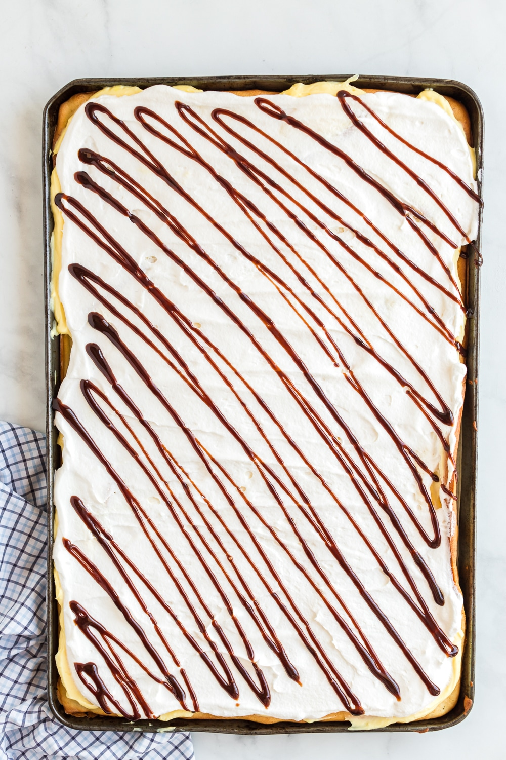 chocolate drizzle on eclair cake