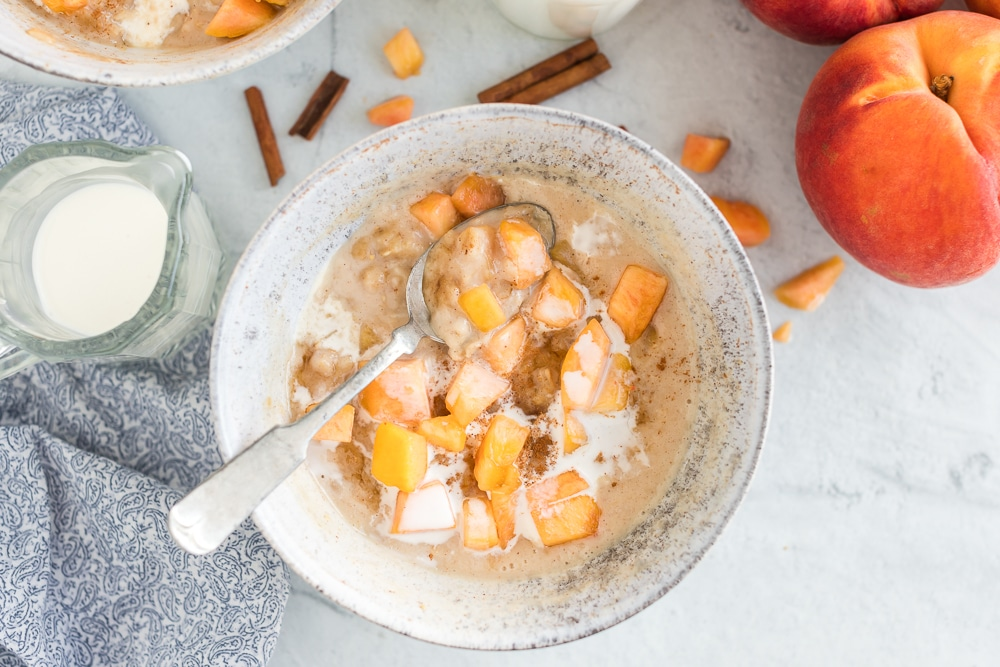peaches in oatmeal topped with cream