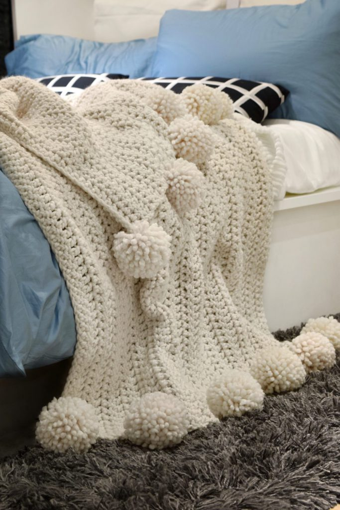 Throw blanket with pom poms