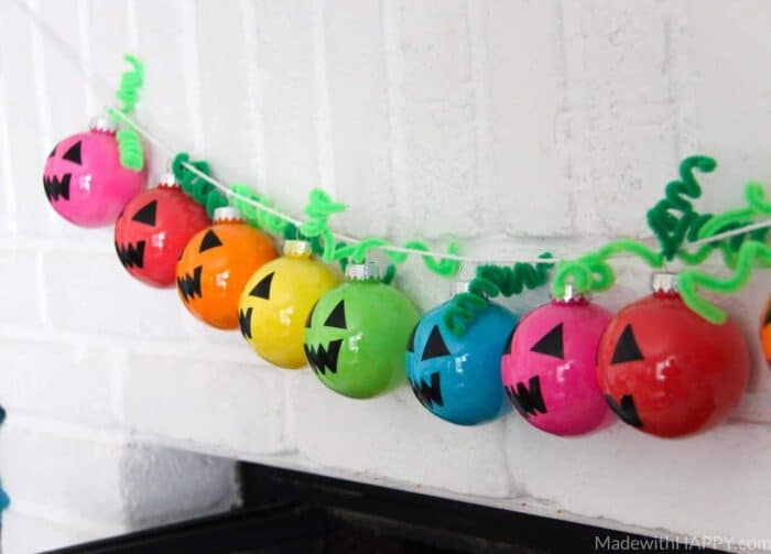 Rainbow Holiday Garland | Plastic Ornament Garland | Colorful Halloween Decorations | Bright Colored Ornaments | www.madewithhappy.com