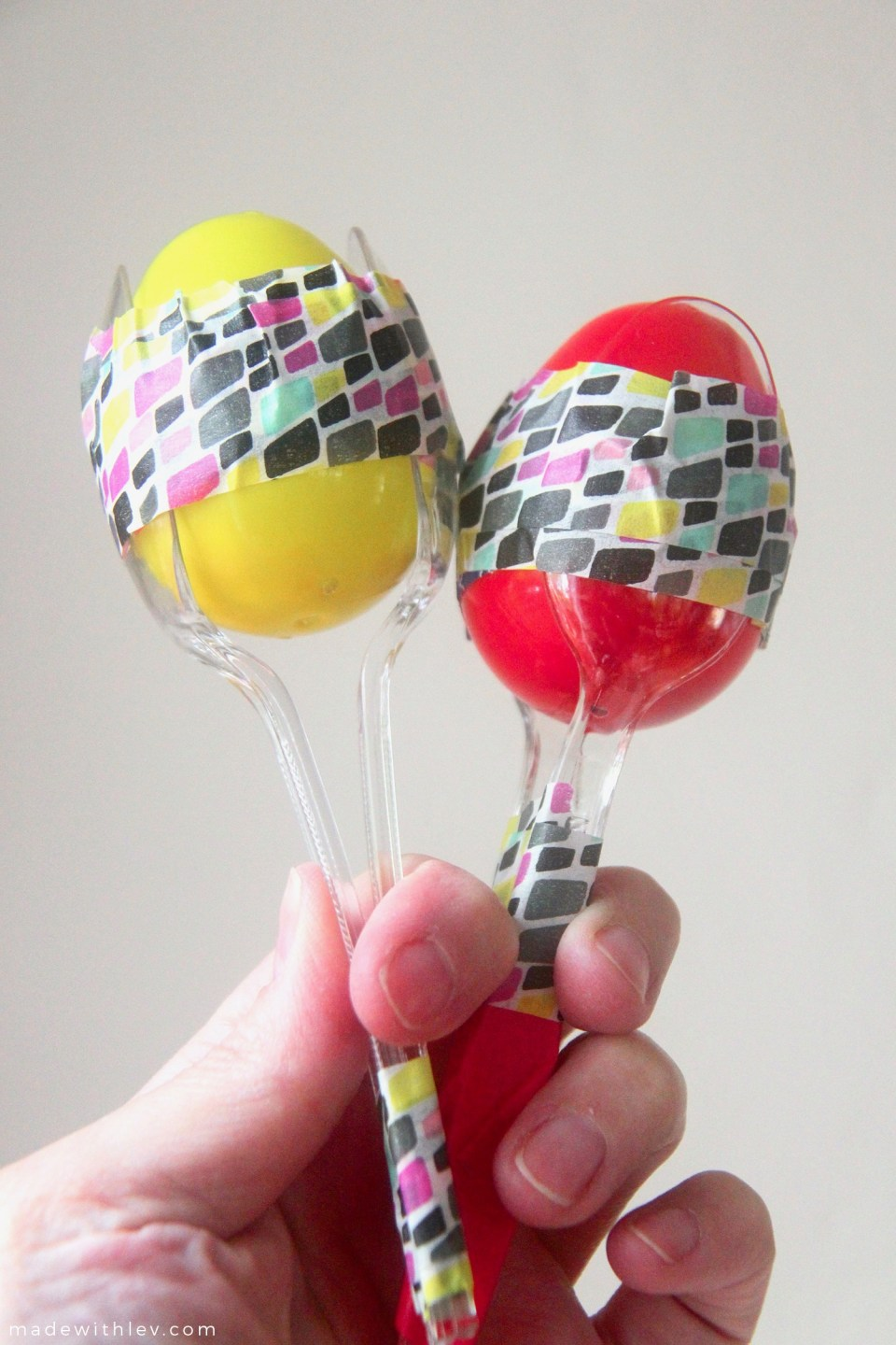 Plastic Egg Maracas for Cinco de Mayo | This project involves minimal supplies and (hopefully) ones that you have in your house already. It's also a really great project to have in your back pocket post-Easter since plastic eggs are seriously on sale.    #musicalinstruments #toddlercrafts #sensoryplay #noisemakers #maracas #cincodemayo #partyfavor #partycraft #colorfulcraft #plasticeggs #kidscrafts #familycrafts #preschoolcraft
