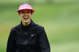 Michelle Wie smiling through the rain at Evian