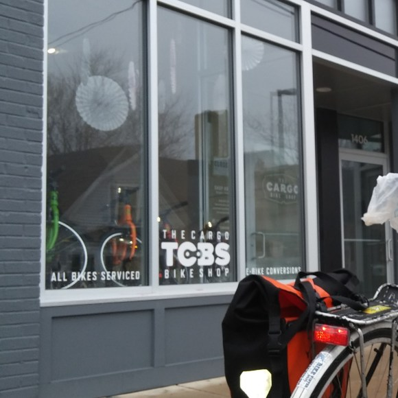 A bike parked in front of the Cargo Bike Shop