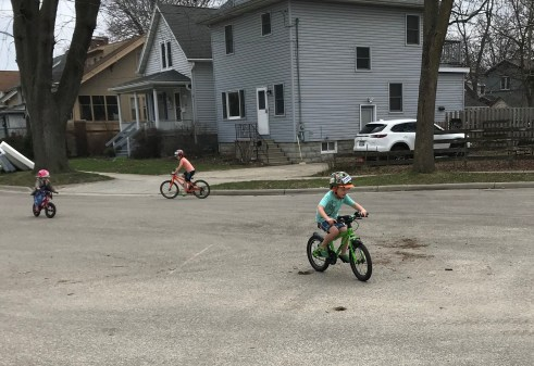 Young kids on bikes in the streets