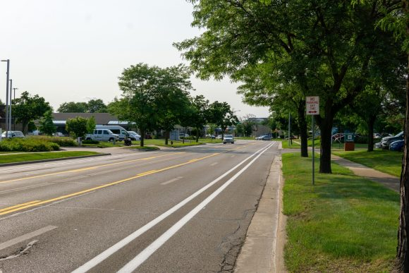 Odana Road in front of Market Square, showing buffered bike lanes and center left turn lane