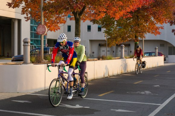 Two cyclists on a tandem along the Monona Terrace bike path
