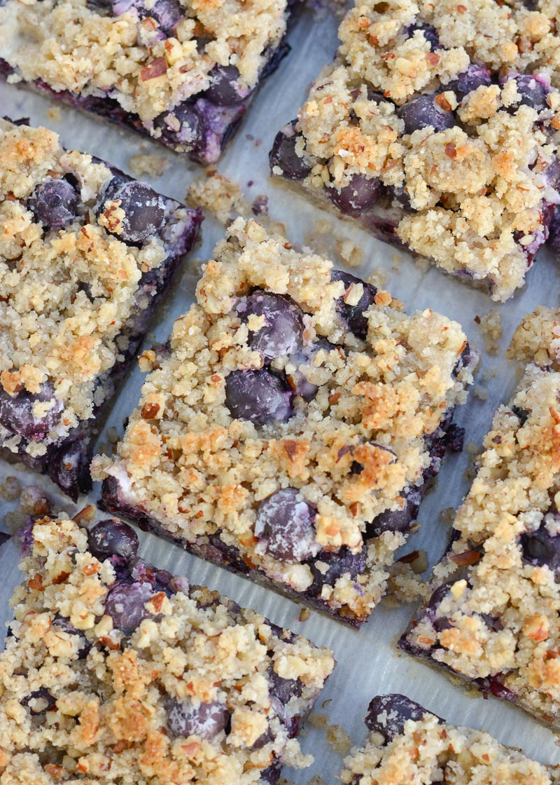 Try these deliciously sweet Keto Blueberry Bars loaded with almond flour, pecans, vanilla and tons of berries! At just 3 net carbs per slice this is the perfect low carb dessert!
