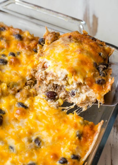 Need an easy recipe to feed a crowd? This Taco Lasagna is loaded with taco meat, black beans, corn and cheese and perfect for busy nights!