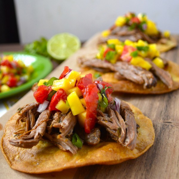 Slow Cooker Shredded Habanero Beef Tostadas with Mango Salsa...finally a good reason to bring out your slow cooker! #glutenfree www.maebells.com