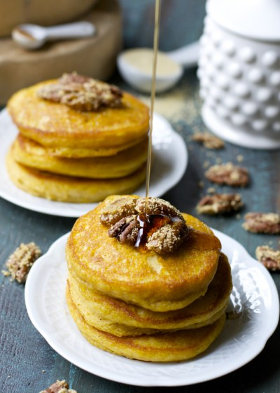 Ultra fluffy Pumpkin Spice Pancakes are topped with Honey Roasted Pecans and warm maple syrup for a decadent Fall breakfast!