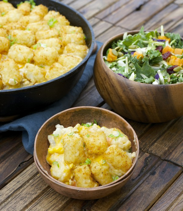 This Lightened Up Tater Tot Casserole is packed with lean ground turkey, loads and vegetables and a creamy homemade cheddar sauce! A perfect dinner for even your pickiest eaters!