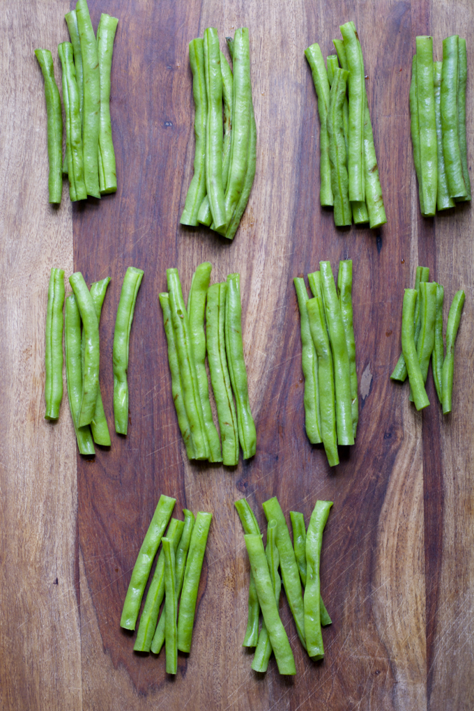Trim the ends from your green beans and stack them into nice neat bundles. The size of your bundles will really depend on how big your green beans are, but I had about 5 in my bundle.