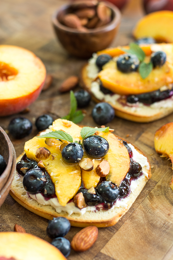 This simple Sweet Peach Bruschetta combine the best flavors of Summer! Fresh peaches, blueberries and mint make for an impressive combination!