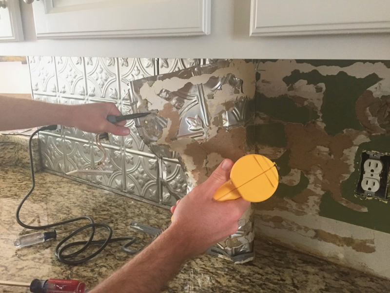 Easily remove a glued on backsplash with our step by step photos and tips! Updated a dated kitchen is easier than you might think, follow along as we remodel our farmhouse!