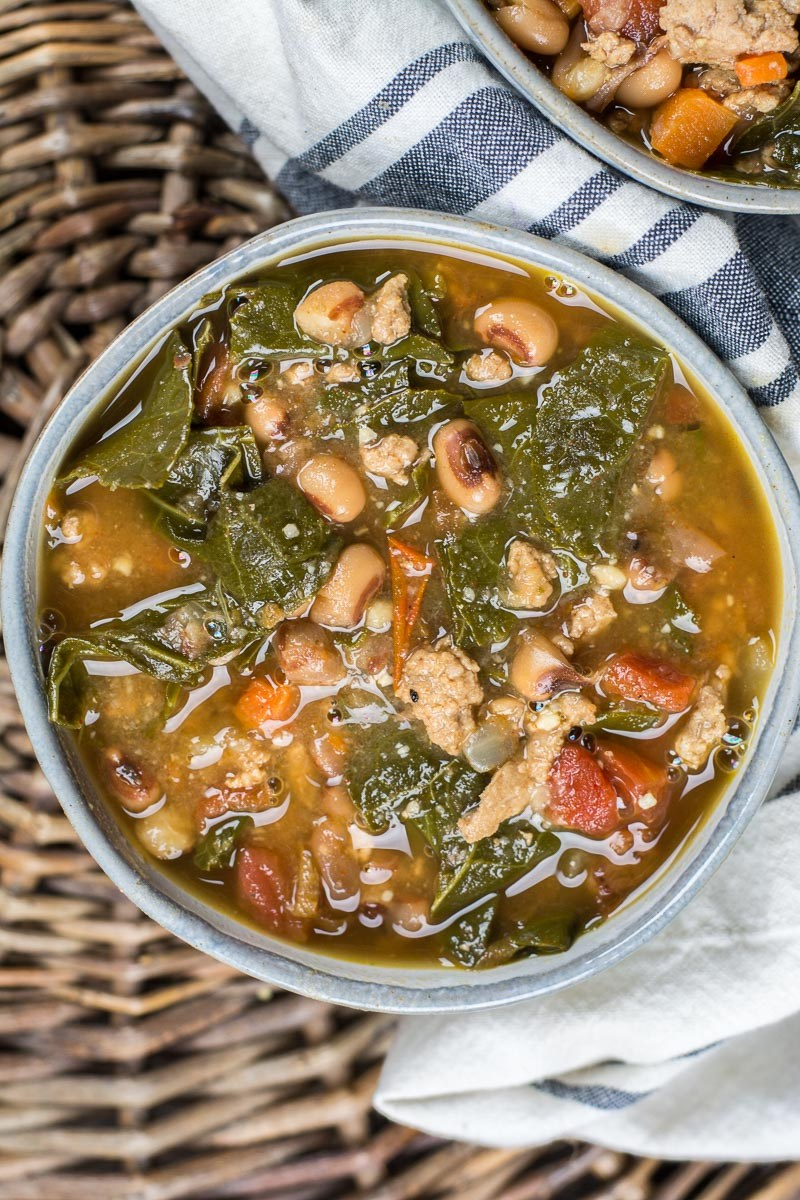 This Collard Green and Black Eyed Pea Soup is the ultimate comfort food! Loaded with ground beef, carrots, collard greens and black eyed peas this is the perfect winter food!